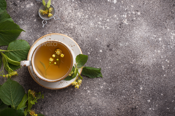 Healthy hot linden tea in cup - Stock Photo - Images
