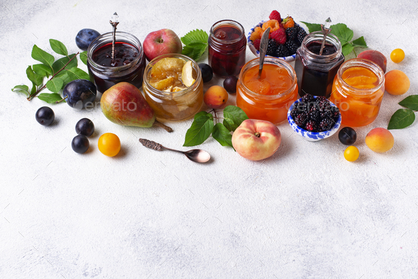 Assortment of different jams in jars - Stock Photo - Images