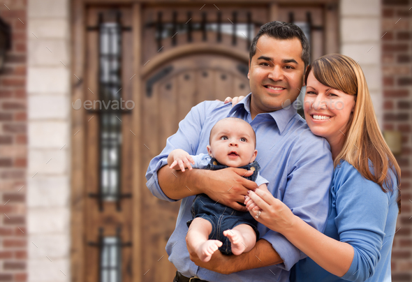 Happy Mixed Race Couple with Baby in Front of House - Stock Photo - Images