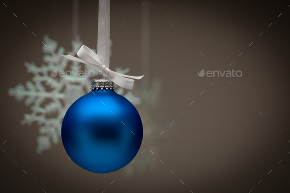Snowflake and Blue Christmas Ornament Against Dark Background - Stock Photo - Images