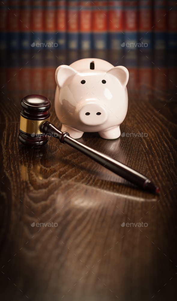 Gavel and Piggy Bank on Wooden Table With Law Books In Background - Stock Photo - Images
