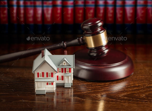 Gavel and Small Model House on Wooden Table. - Stock Photo - Images
