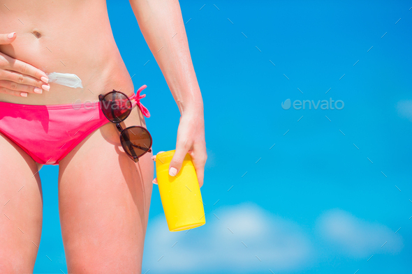 Beautiful woman body in bikini and sunglasses over blue sea bckground - Stock Photo - Images