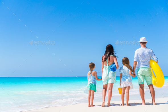 Young family on vacation on the beach. Family travel concept - Stock Photo - Images