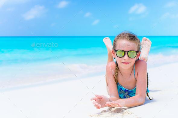 Little cute girl on the seashore enjoy beach holiday - Stock Photo - Images