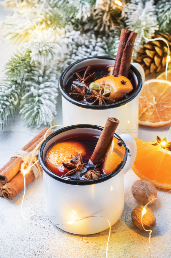 Mulled wine in white metal mugs - Stock Photo - Images