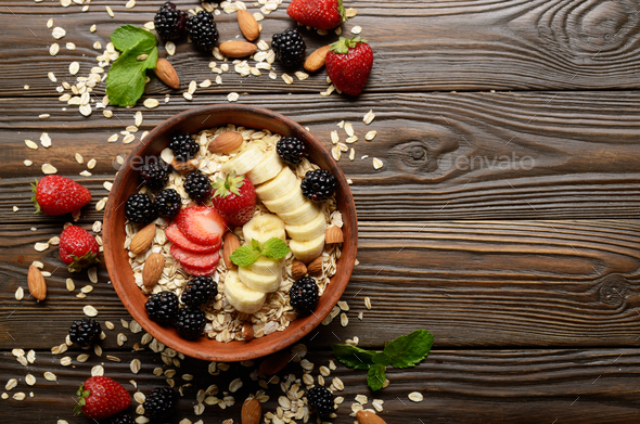 Flat lay top view at Fruit healthy muesli with banana strawberry almonds - Stock Photo - Images