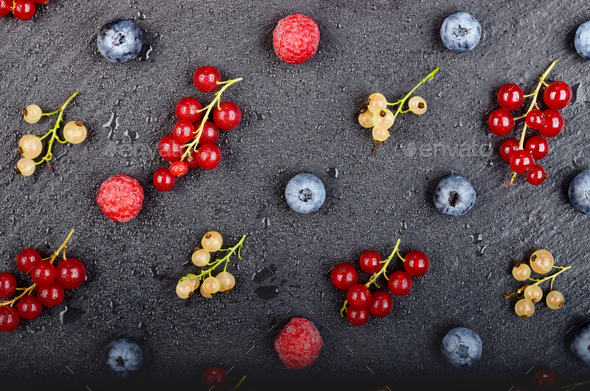 Flat lay view at ripe bilberry raspberry white and red currant on slate stone tray closeup - Stock Photo - Images