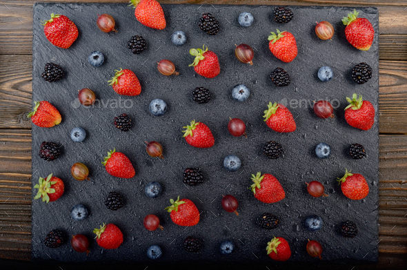 Flat lay view at ripe bilberry strawberry raspberry blackberry - Stock Photo - Images