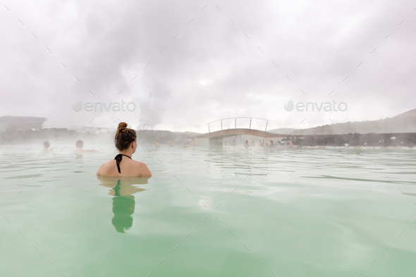 Woman taking a relaxing bath while relaxing in hot spring - Stock Photo - Images