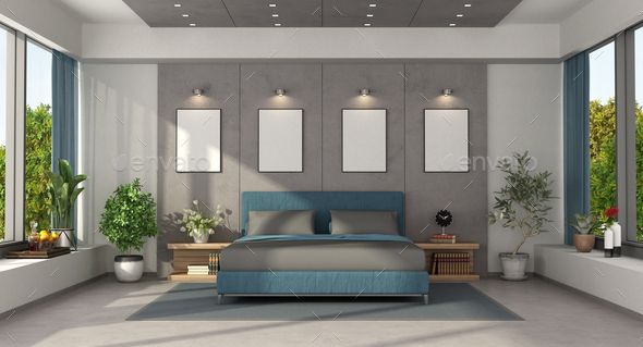 Modern master bedroom with blue double bed - Stock Photo - Images