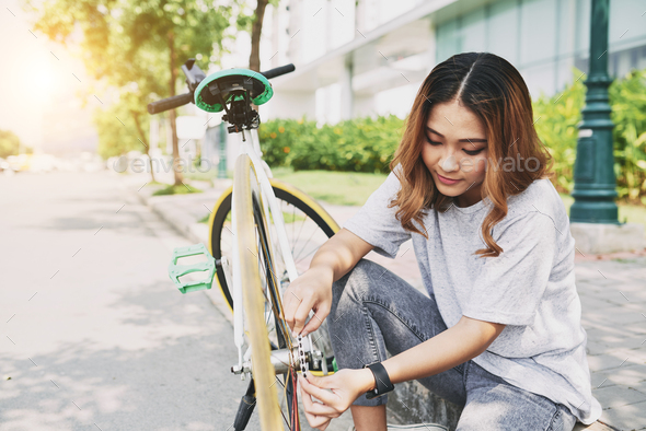 Fixing bicycle - Stock Photo - Images
