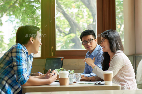 Students discussing project - Stock Photo - Images