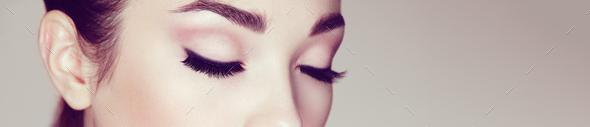 Female eye with long false eyelashes - Stock Photo - Images