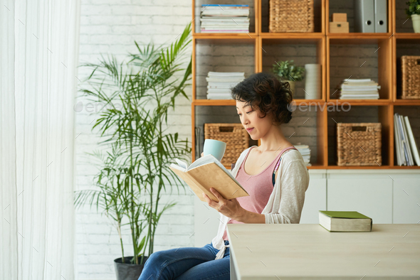 Wrapped up in Reading Novel - Stock Photo - Images