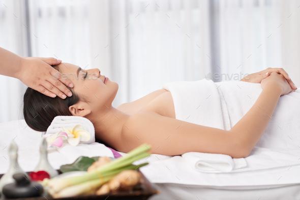 Enjoying head massage - Stock Photo - Images