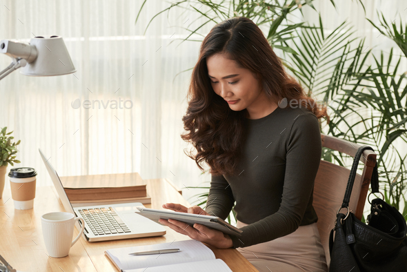 Elegant business lady with digital tablet - Stock Photo - Images