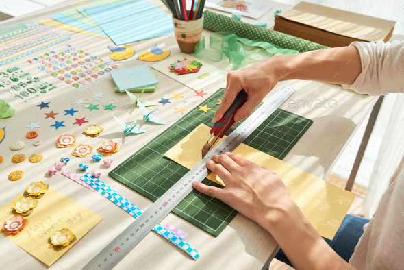 Creative Woman Concentrated on Scrapbooking - Stock Photo - Images