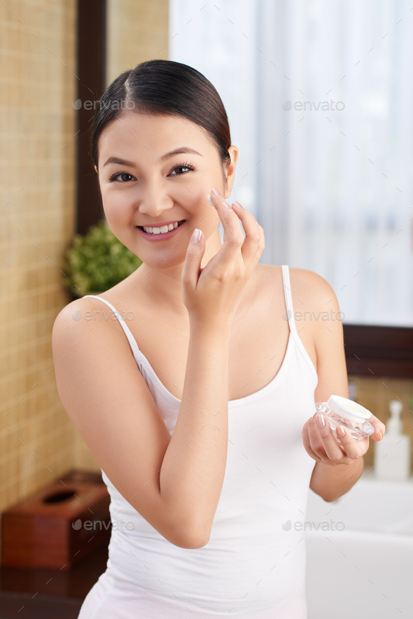 Applying daily lotion - Stock Photo - Images