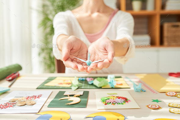Talented Craftswoman with Origami Crane - Stock Photo - Images