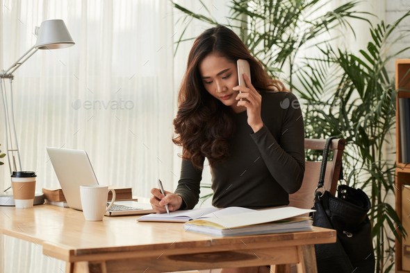 Young woman busy with work - Stock Photo - Images