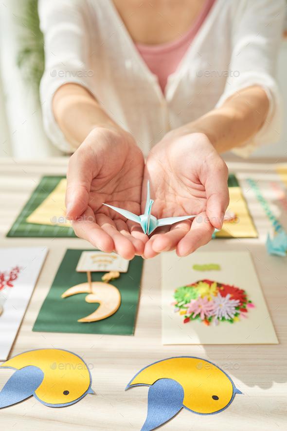 Female Hands Holding Origami Crane - Stock Photo - Images