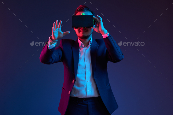 Businessman in vr glasses - Stock Photo - Images