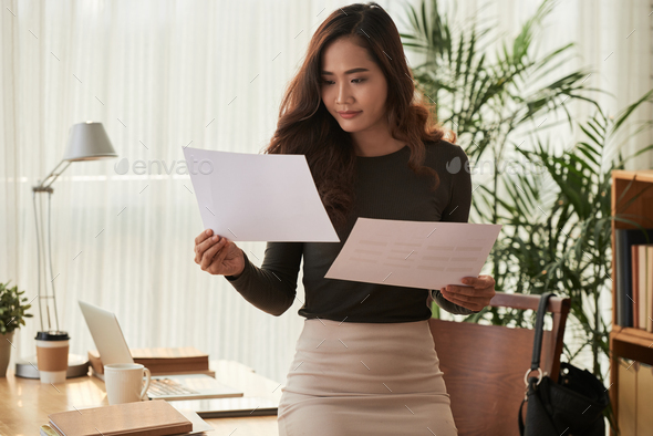 Checking business reports - Stock Photo - Images