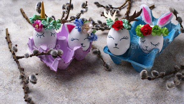 Easter eggs in shape of bunny, cat and deer - Stock Photo - Images