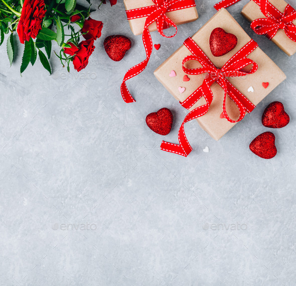Valentine Day background with red hearts, gift boxes with red ribbons and red roses. - Stock Photo - Images