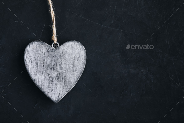 Valentines Day background with heart. Homemade wooden rustic heart on dark blackboard - Stock Photo - Images