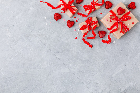 Valentine Day background with red hearts and a gift boxes with red ribbons. - Stock Photo - Images