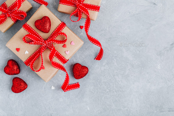 Valentine Day background with red hearts, gift boxes with red ribbons. - Stock Photo - Images