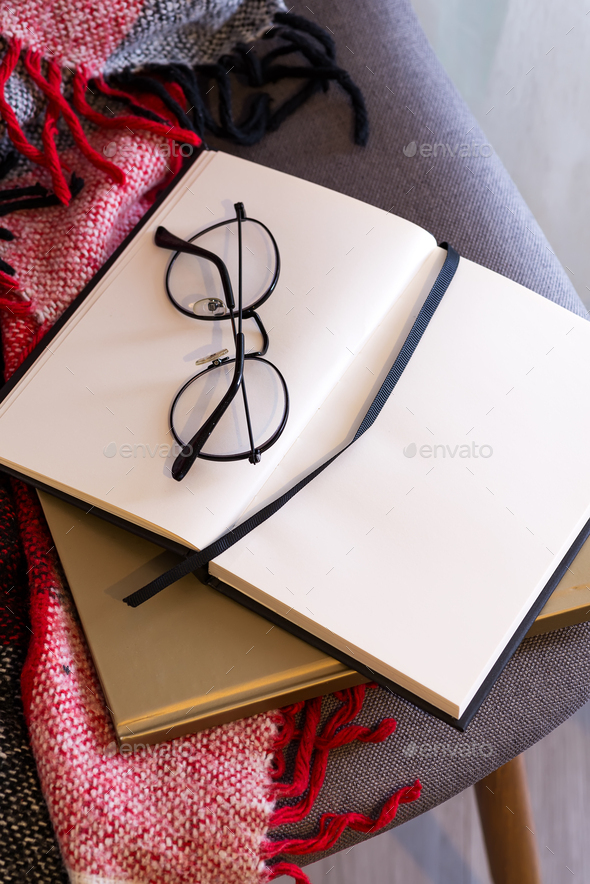 Notebook with glasses on a red plaid . Concept comfort - Stock Photo - Images