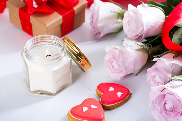 Homemade Valentines day heart cookies, pink roses and candle on white table , copy space - Stock Photo - Images