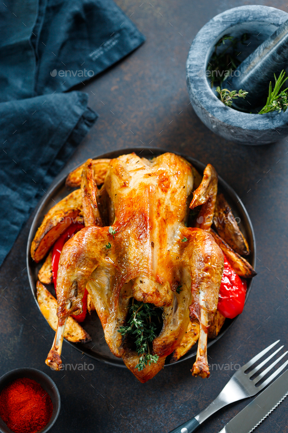 Roasted guinea fowl with herbs - Stock Photo - Images