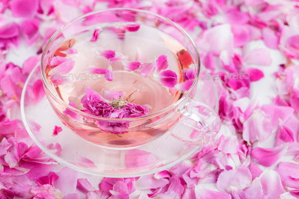 Tea with rose petals in a glass Cup. Rose water.Concept Holiday Valentine Day. - Stock Photo - Images