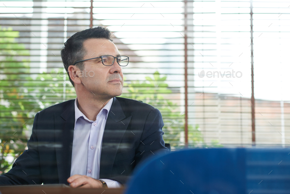 Pensive business executive - Stock Photo - Images