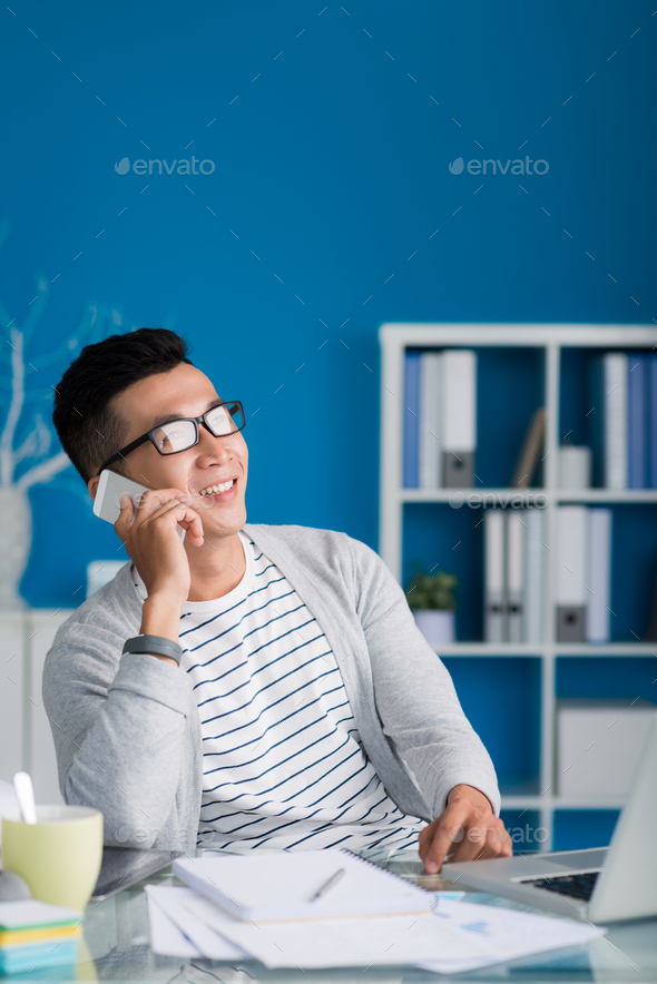 Young man calling on phone - Stock Photo - Images