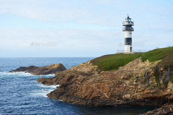 Illa Pancha lighthouse in Ribadeo, Galicia, Spain - Stock Photo - Images
