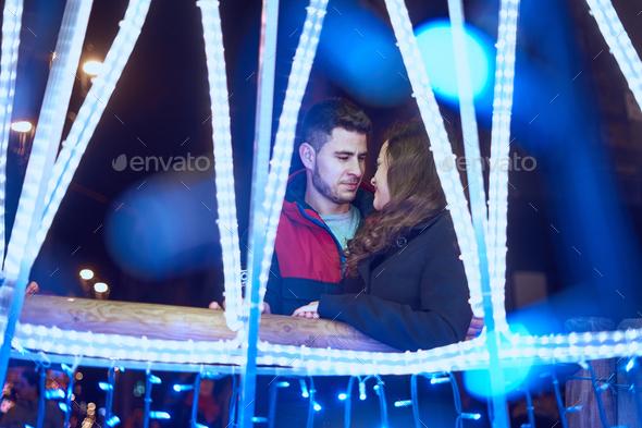 Young couple enjoying Christmas Lights - Stock Photo - Images