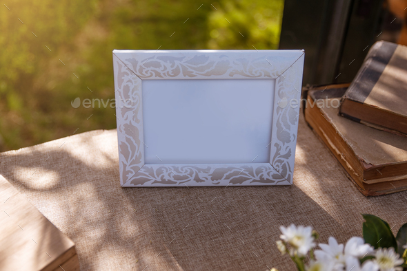 Photo frame surrounded by objects at a wedding - Stock Photo - Images