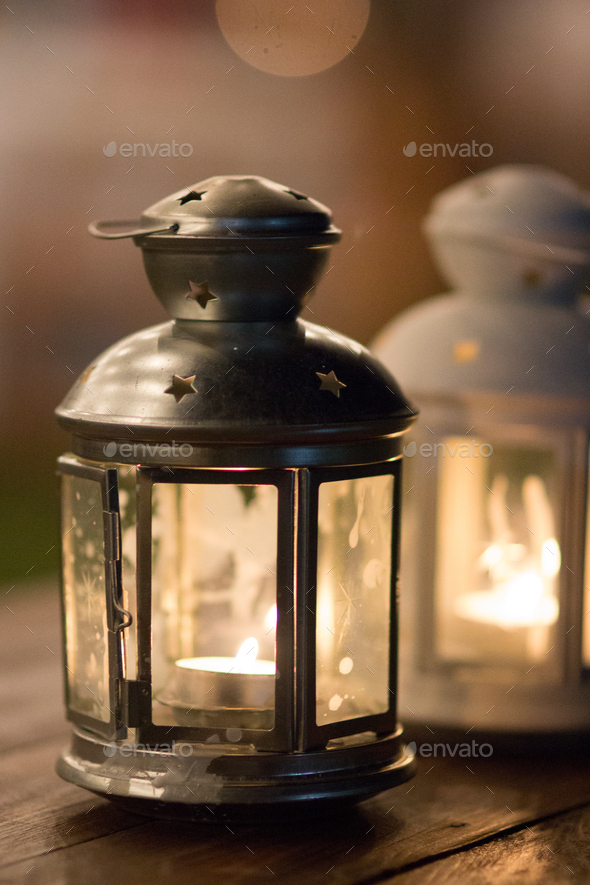 Lanterns on a wood table on an outdoors wedding banquet - Stock Photo - Images