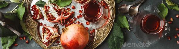 Pomegranate tea on dark background, flat lay - Stock Photo - Images