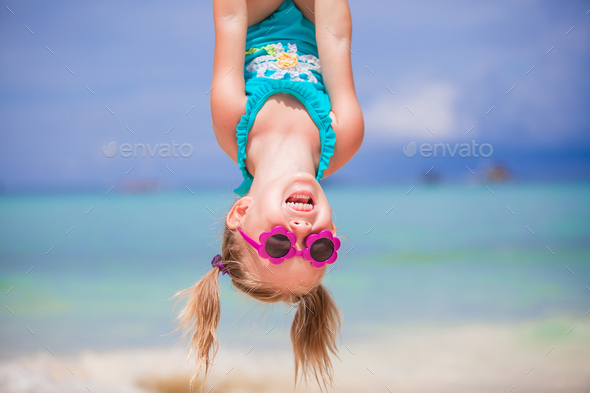 Adorable happy little girl outdoors during summer vacation have fun with her young father - Stock Photo - Images