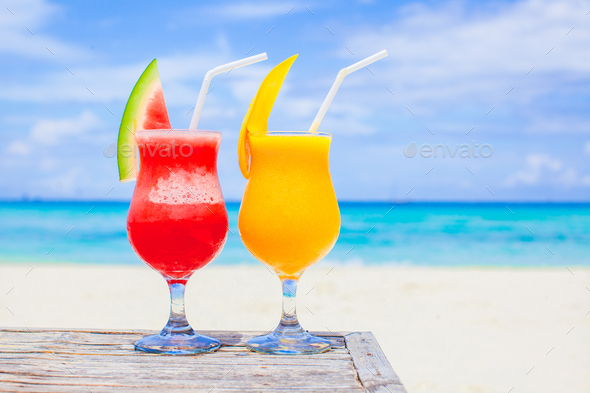 Fresh watermelon and mango cocktails on the background of turquoise sea - Stock Photo - Images
