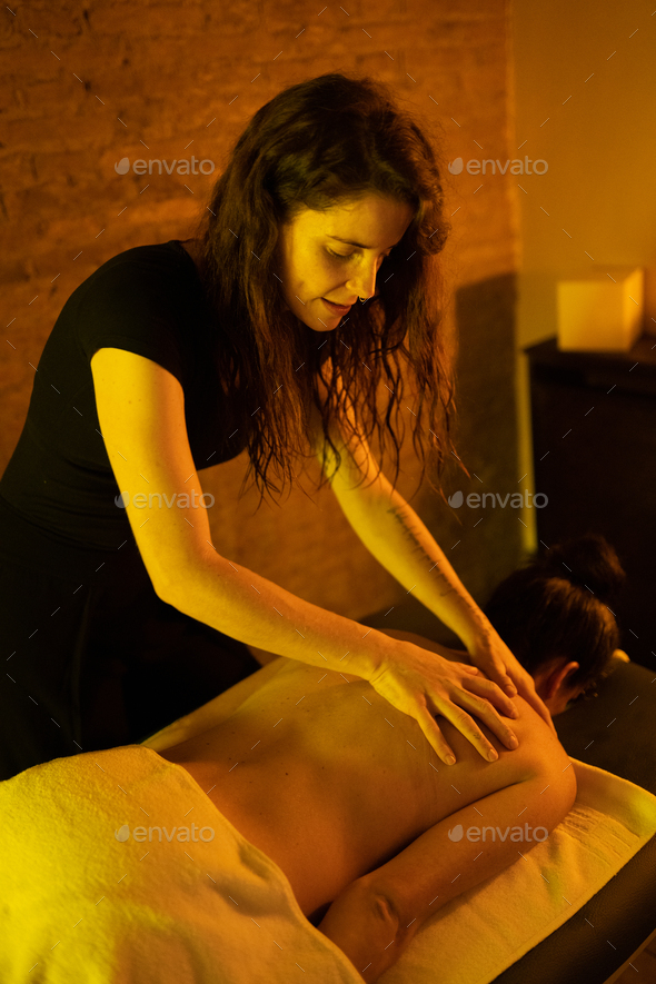 Woman receiving back massage in Arab Baths - Stock Photo - Images