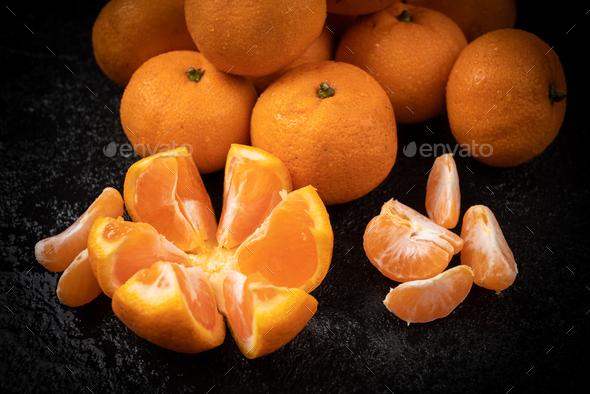 Juicy mandarin on  black background. Mandarin Fruit - Stock Photo - Images