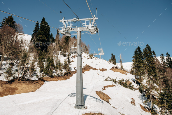 Cableway Ski Lifts. Cable car in the mountains. Trees in the mountains near the cable car. - Stock Photo - Images