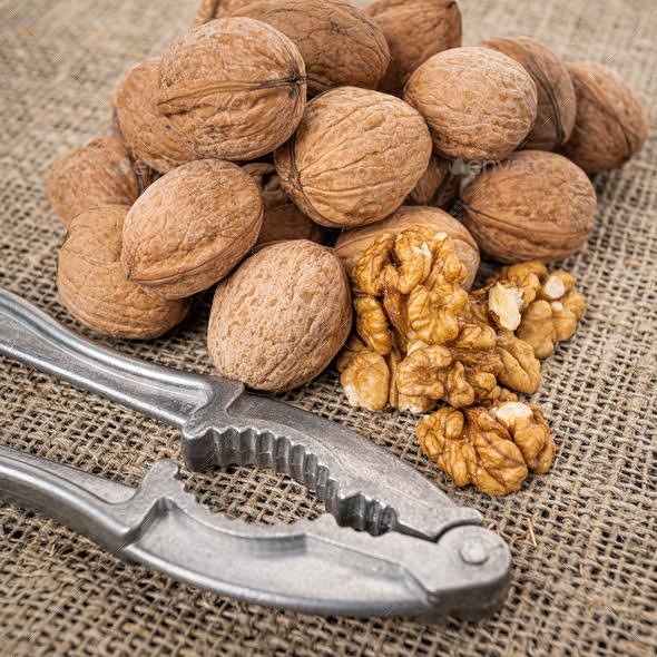 Walnut kernel background. Nutcracker with walnut - Stock Photo - Images